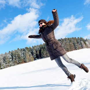 Girl jumping on snow